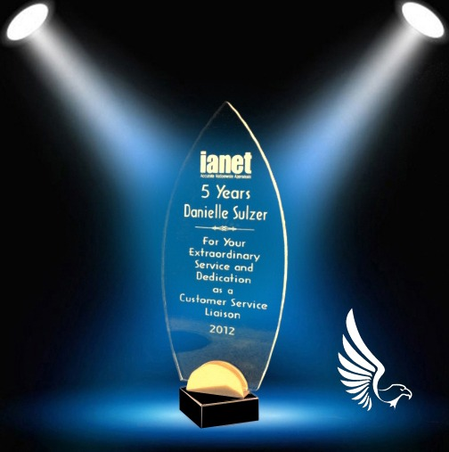 Surfboard-shaped flame award with clear etching