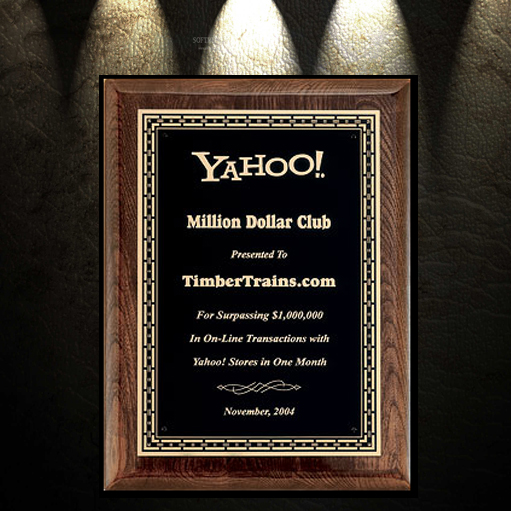 Plaque with black background gold text and wooden frame