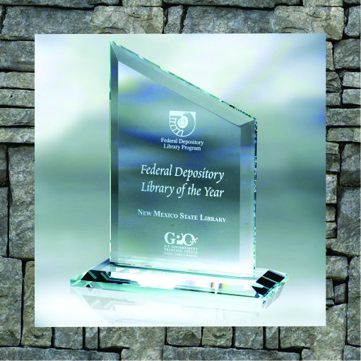 Glass trophy with base and text with federal depository library of the year