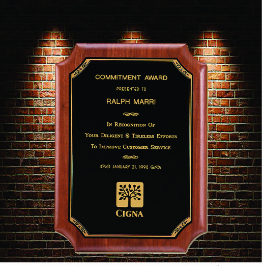 Commemorative plaque with black background and gold text